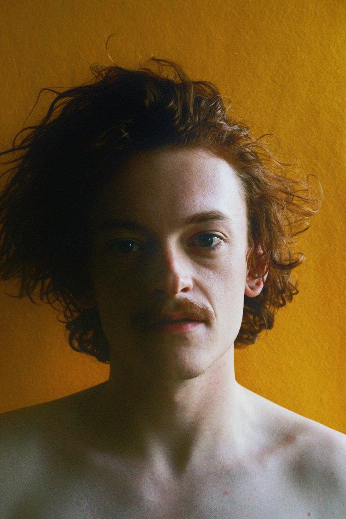 Mike Van Roosbroeck 1 mini - Portraits at home by James Barnett, a series against yellow黄色背景的艺术
